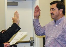 John Main gets sworn in by Rockwall County Judge David Sweet.
