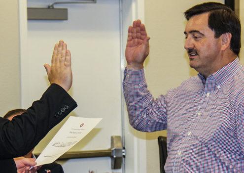 John Main gets sworn in by Rockwall County Judge David Sweet.